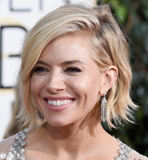 BEVERLY HILLS, CA - JANUARY 11: Actress Sienna Miller attends the 72nd Annual Golden Globe Awards at The Beverly Hilton Hotel on January 11, 2015 in Beverly Hills, California. (Photo by Frazer Harrison/Getty Images)